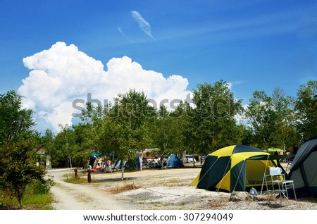 Summer camping, campsite in the foothills of Japan Alps, Japan - stock photo
