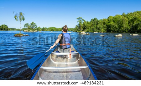 Summer canoeing on Swedish lake