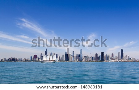 summer Chicago skyline with tallship and airship - stock photo
