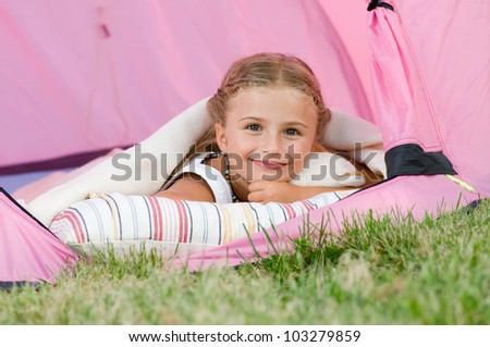 Summer, child camping in tent - lovely girl on camp tent - stock photo