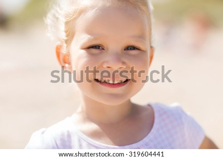 summer, childhood, happiness and people concept - happy beautiful little girl portrait outdoors