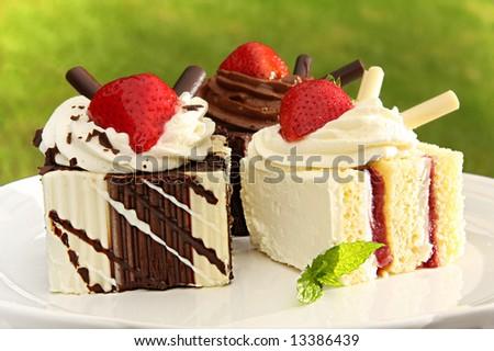 Summer chocolate and strawberry dessert cakes. - stock photo