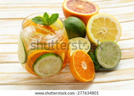 Summer citrus lemonade with orange, lime and  lemon - stock photo