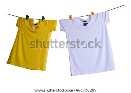 Summer clothes  hang on robe line on isolated background.