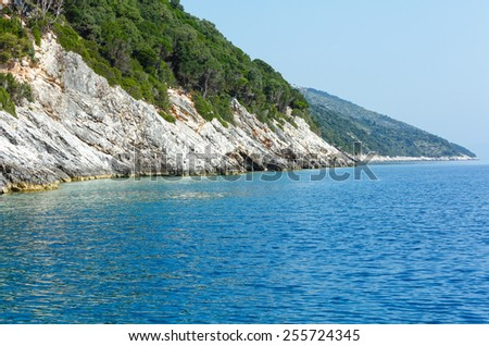 Summer coast view from motorboat (Kefalonia, not far from Agia Effimia, Greece) - stock photo