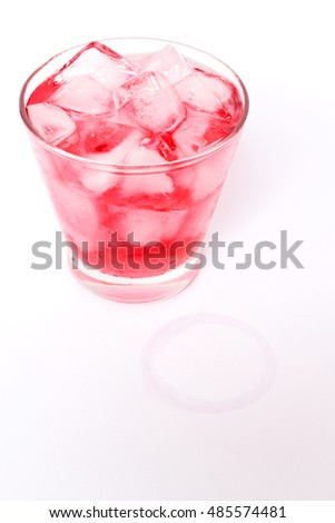 Summer cocktail; fresh juice with sparkling on ice and glass stains isolated on white background