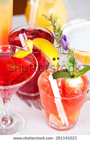 Summer cocktails with pieces of fruit on white background
