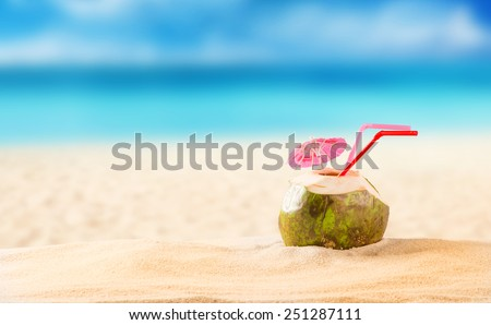 summer coconut cocktail on tropical beach. - stock photo