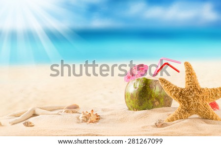 summer coconut cocktail on tropical beach. - stock photo