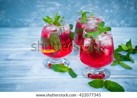 Summer cold drink. Lemonade with mint and raspberries. - stock photo