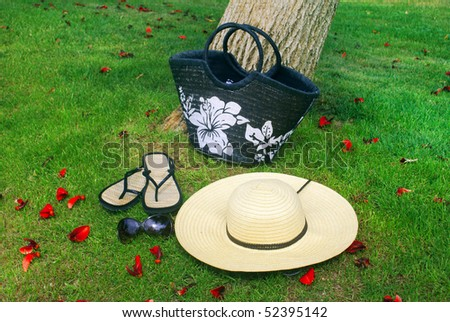 Summer complect : Hat , bag , sunglasses and flip-flops - stock photo