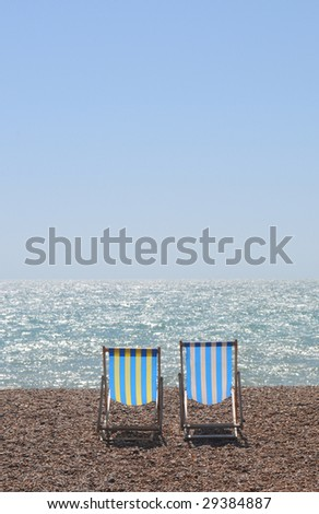 summer concept. chairs on the beach.