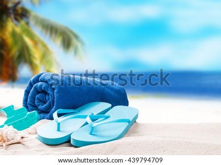 Summer concept, flip-flops, summer accessories on summer beach background - stock photo