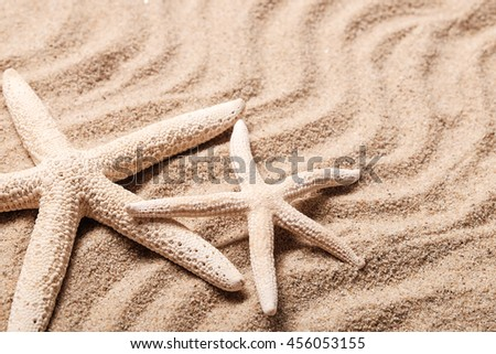 Summer concept, Idea for starfish on sand with space for text.