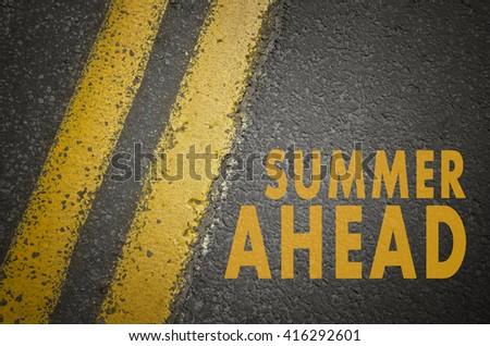 Summer concept. Summer ahead written on asphalt road. - stock photo