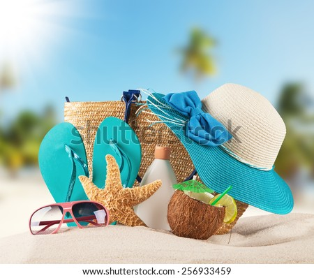 Summer concept with sandy beach, shells and blue sandals - stock photo