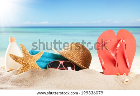 Summer concept with swimming accessories and blur sea on background - stock photo
