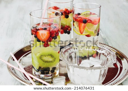 summer cool drink with fresh berries and fruit on the old wooden background. health and diet food - stock photo