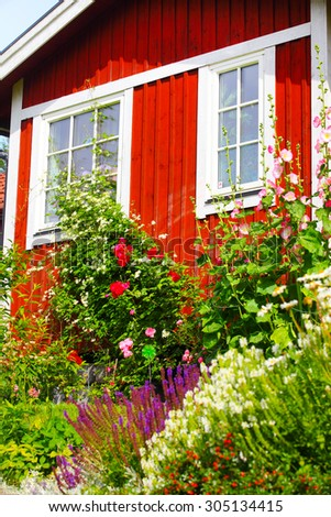 summer cottage with flower in the garden - stock photo