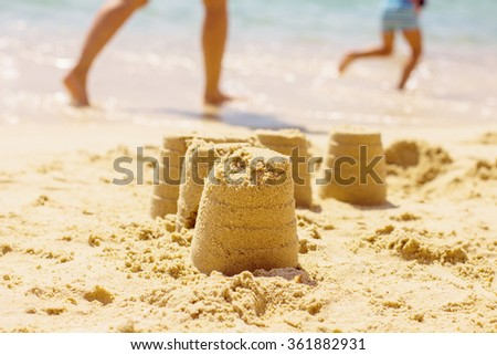 Summer Creative Fun sandcastle on the beach. - stock photo