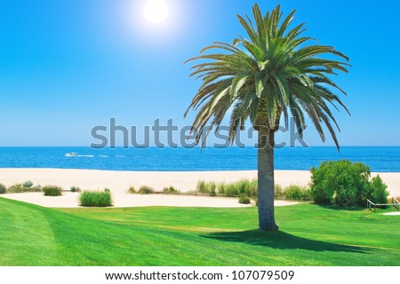 Summer day on the golf course and ocean in Portugal. - stock photo