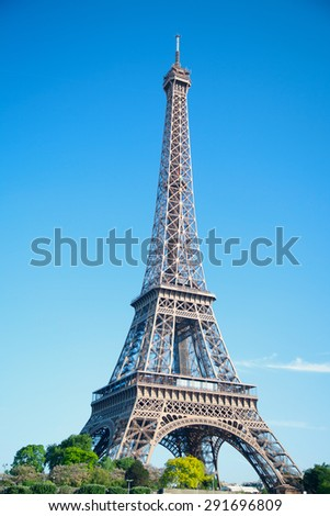 summer day the sun shines over the Eiffel Tower symbol of Paris. Travel to Europe and France