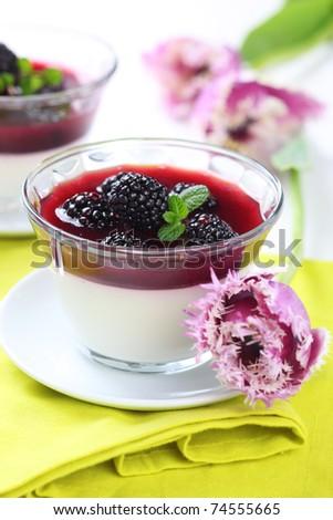 summer dessert with blackberries and cream - stock photo