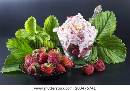 Summer dessert with strawberries on black background - stock photo