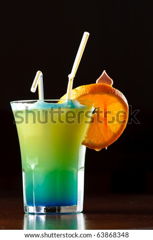 Summer drink decorated with a slice of orange - stock photo