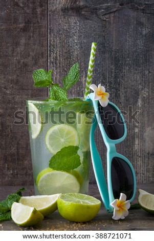 Summer drink. Fresh mojito with lime and mint on rustic wood