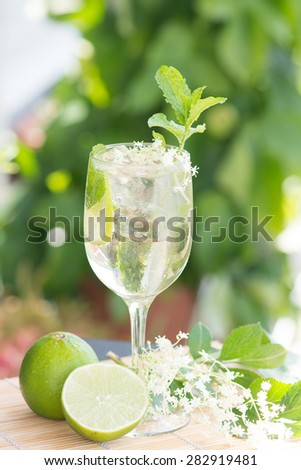 summer drink Hugo Champagne drink with elderflower syrup, mint and lime - stock photo