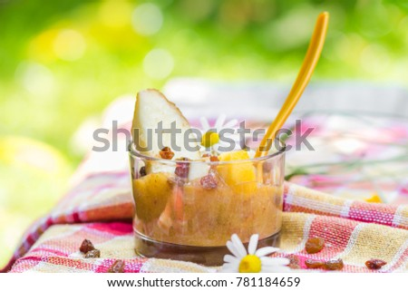 Summer drink in the garden: smoothie with pears, nectarines and raisins