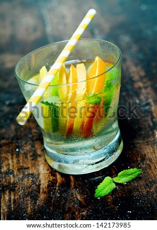Summer drink on a wooden bar counter. - stock photo