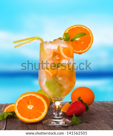 Summer drink with blur beach on background - stock photo