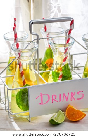 Summer drink with straw and fruits