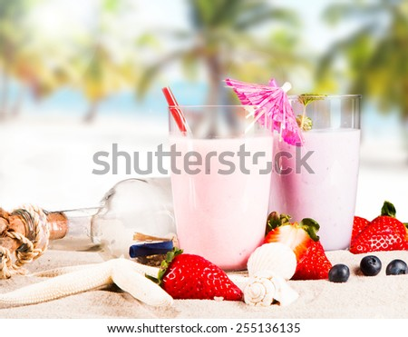 Summer drinks on sandy beach with blur beach background - stock photo