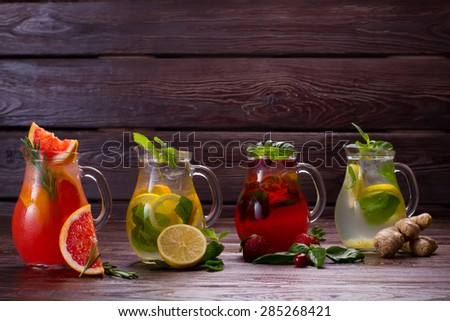 Summer drinks with ice, fresh berries and citrus fruits. Different types of fresh lemonades. - stock photo