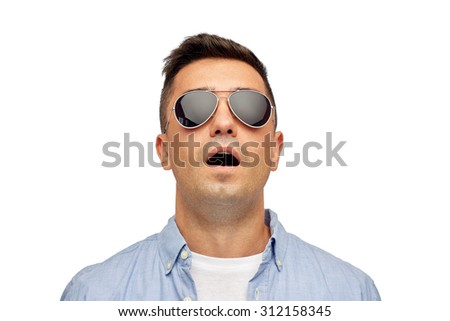 summer, emotions, style and people concept - face of scared or surprised middle aged latin man in shirt and sunglasses - stock photo