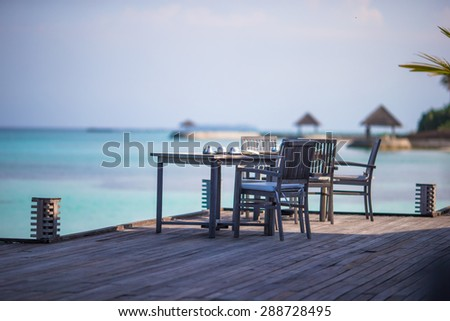 Summer empty outdoor cafe at exotic island in indian ocean - stock photo