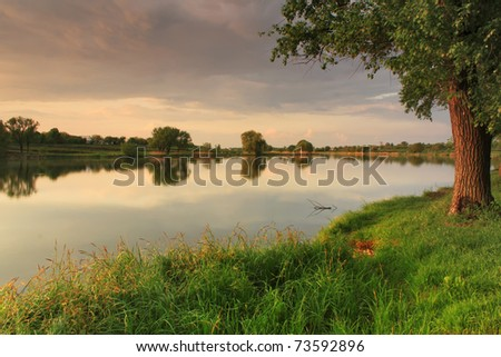 Summer evening on the shore of Lake - stock photo