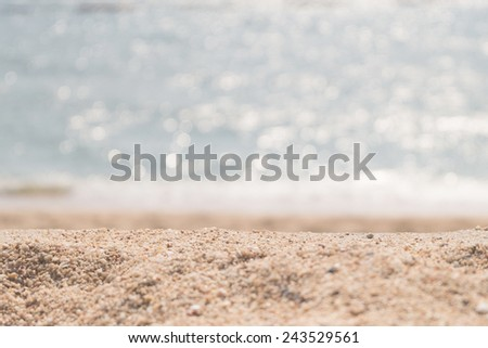 Summer exotic sandy beach with sea on background - stock photo