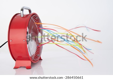 Summer fan with blowing tassles on white - stock photo