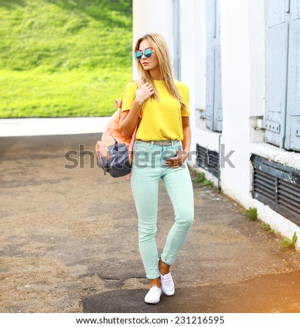 Summer, fashion and people concept - stylish pretty hipster woman in sunglasses outdoors in city - stock photo