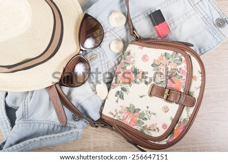 Summer fashion woman stuff on wooden background - stock photo