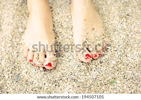 Summer, feet on the beach - stock photo