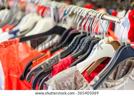 Summer Female Dresses at a Store. CloseUp shot with a selective focus - stock photo