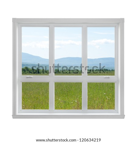 Summer field and mountains seen through the window. - stock photo