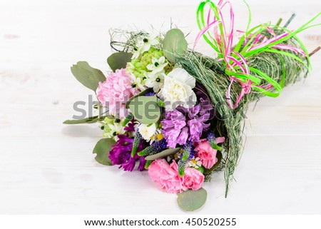 Summer Field bouquet on wooden white background, space for text