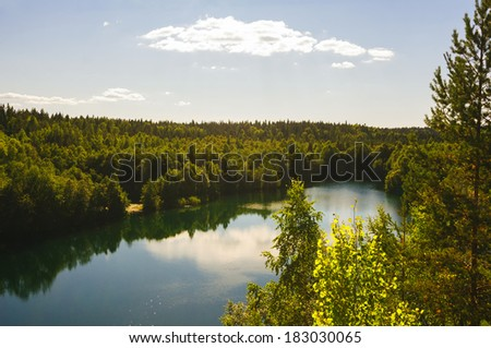 Summer fir forest and lake landscape (Karelia, Russia) - stock photo
