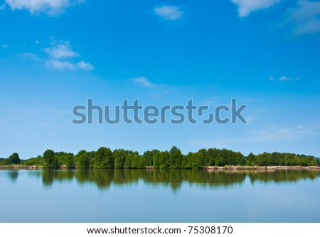 Summer forest river with reflection of the sky - stock photo